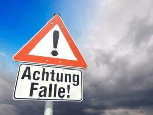 Versteckte Kosten Bei Krediten Entlarven Schild Achtung Falle